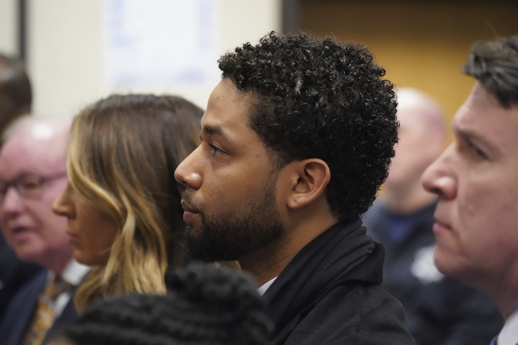 Actor Jussie Smollett, center, appears in a courtroom at the Leighton Criminal Court Building in Chicago on Feb. 24, 2020, where he plead not guilty t...