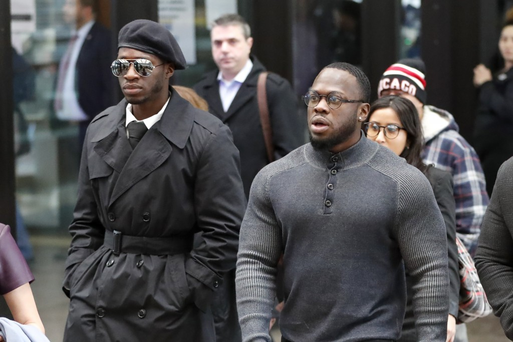 CORRECTS IDS OF BROTHERS- Brothers Olabinjo Osundairo, right, and Abimbola Osundairo arrive at the Leighton Criminal Courthouse in Chicago on Monday, ...