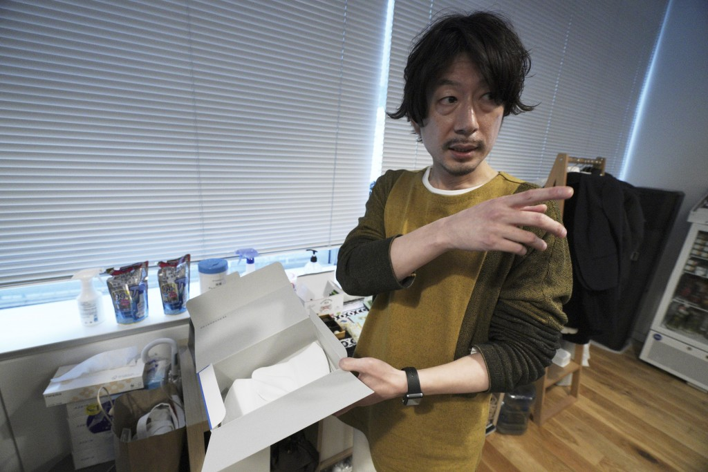 Naokazu Wakaguri, Managing Director of an artificial intelligence company GumGum Japan, speaks as he shows the protective mask for staff Tuesday, Feb....