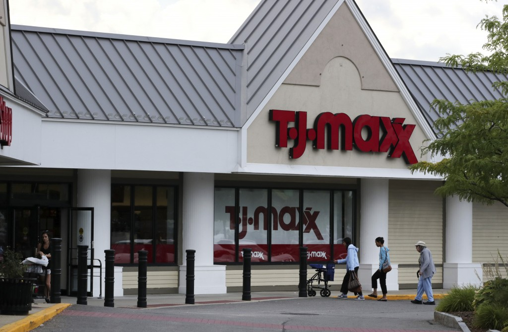 FILE - In this Aug. 15, 2019, file photo shoppers enter the TJ Maxx store in Manchester, N.H. TJX Companies Inc., parent of T.J. Maxx and other discou...