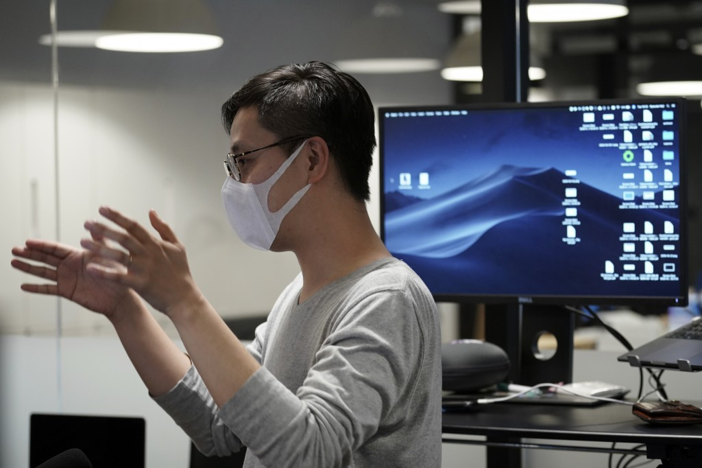 Ryosuke Noji, Technical Solutions Manager of an artificial intelligence company GumGum Japan, speaks at the office Tuesday, Feb. 25, 2020, in Tokyo. J...