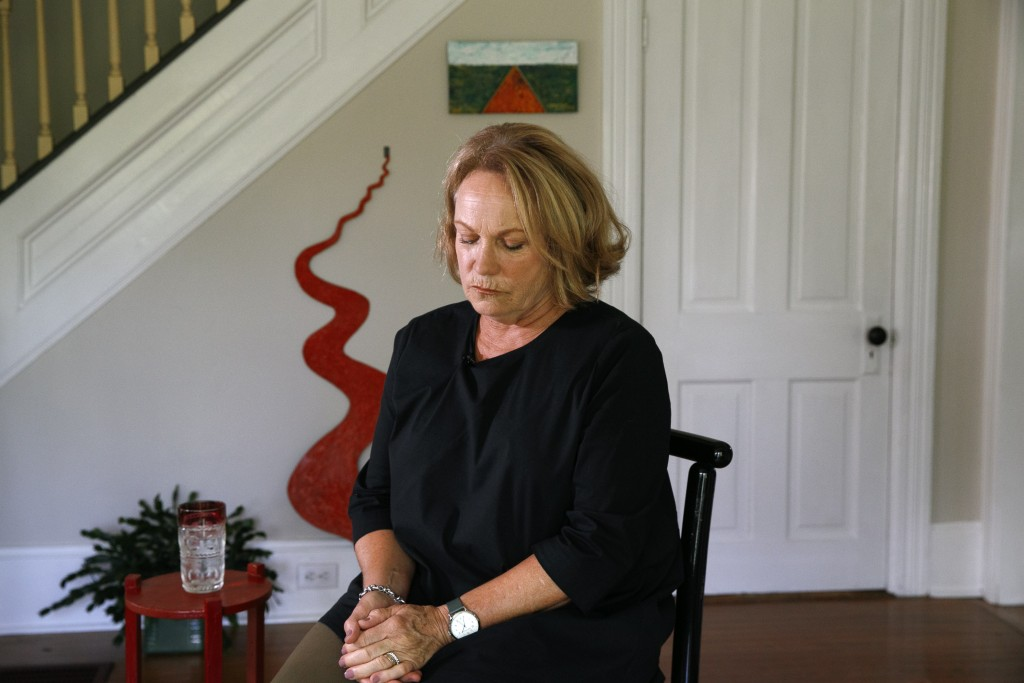 FILE - In this Friday, July 12, 2019 file photo, former opera singer Patricia Wulf pauses during an interview in her home in Virginia. Wulf expressed ...