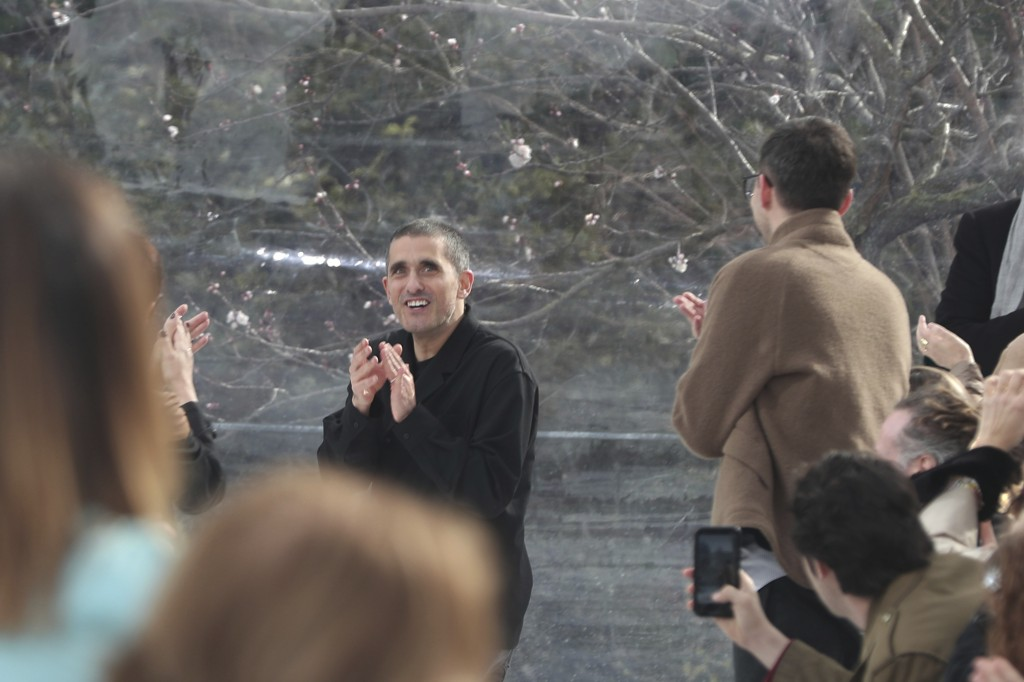 Designer Felipe Oliveira Baptista, centre, accepts applause at the conclusion of the Kenzo fashion collection during Women's fashion week Fall/Winter ...
