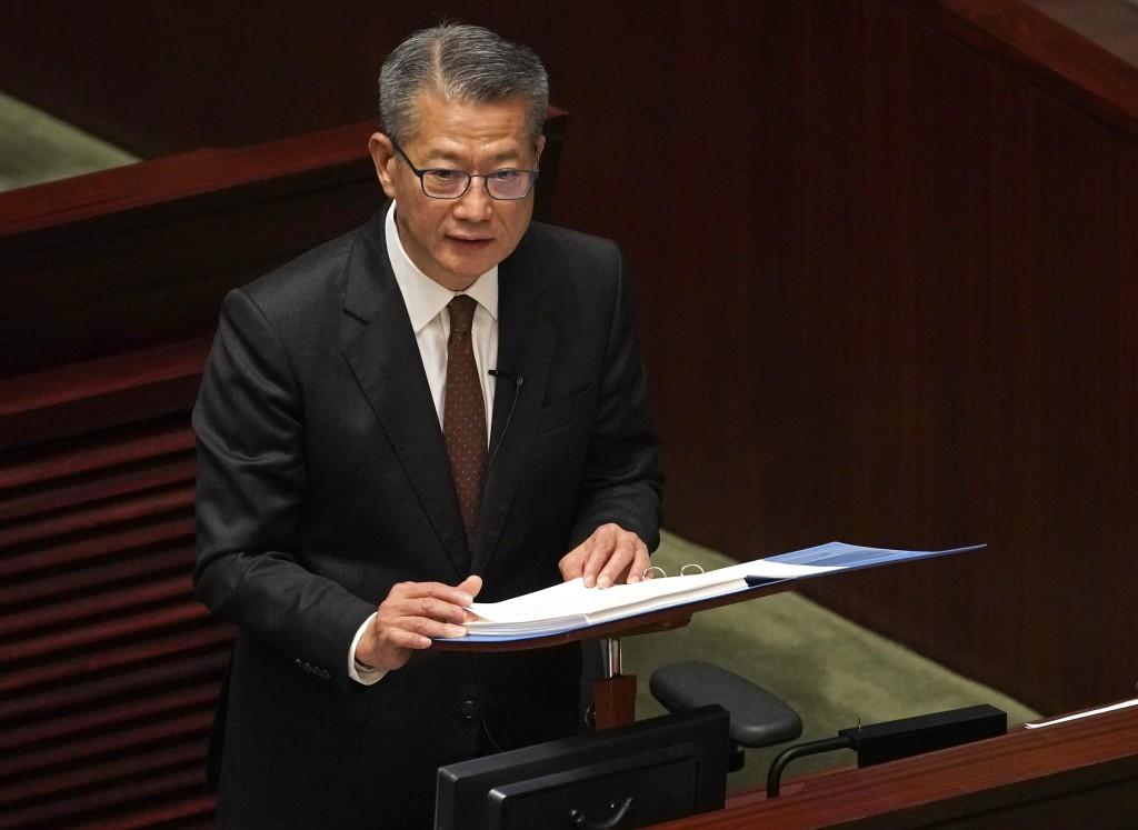 Hong Kong's Financial Secretary Paul Chan delivers his annual budget speech at the Legislative Council in Hong Kong Wednesday, Feb. 26, 2020.  Hong Ko...