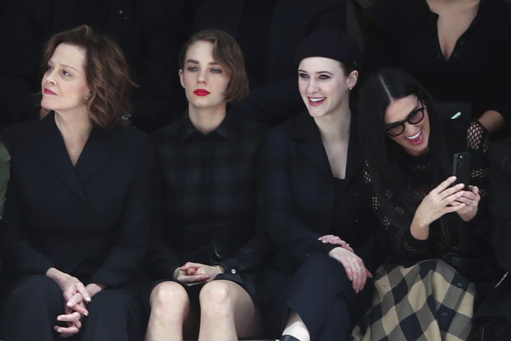 From left, Sigourney Weaver, her daughter Charlotte, Rachel Brosnahan and Demi Moore attend the Dior fashion collection during Women's fashion week Fa...