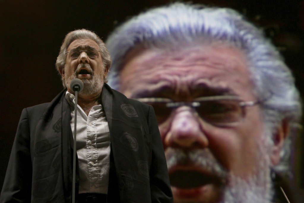 FILE - In this Dec. 19, 2009, file photo, Placido Domingo performs during a sound check prior to a free concert in Mexico City. In a statement release...