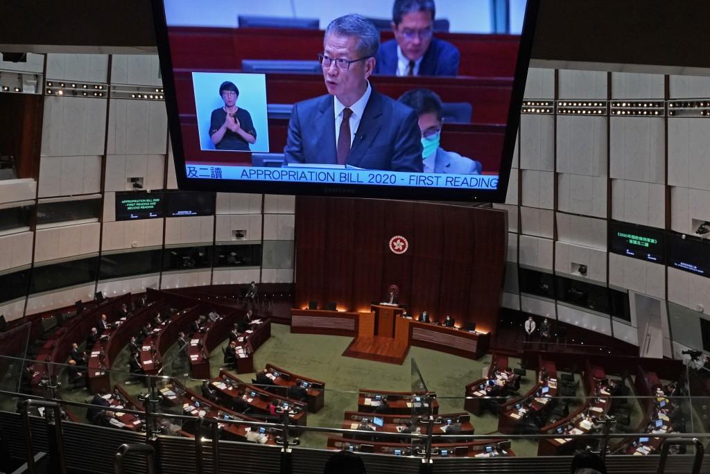 A screen shows Hong Kong's Financial Secretary Paul Chan delivers his annual budget speech at the Legislative Council in Hong Kong Wednesday, Feb. 26,...