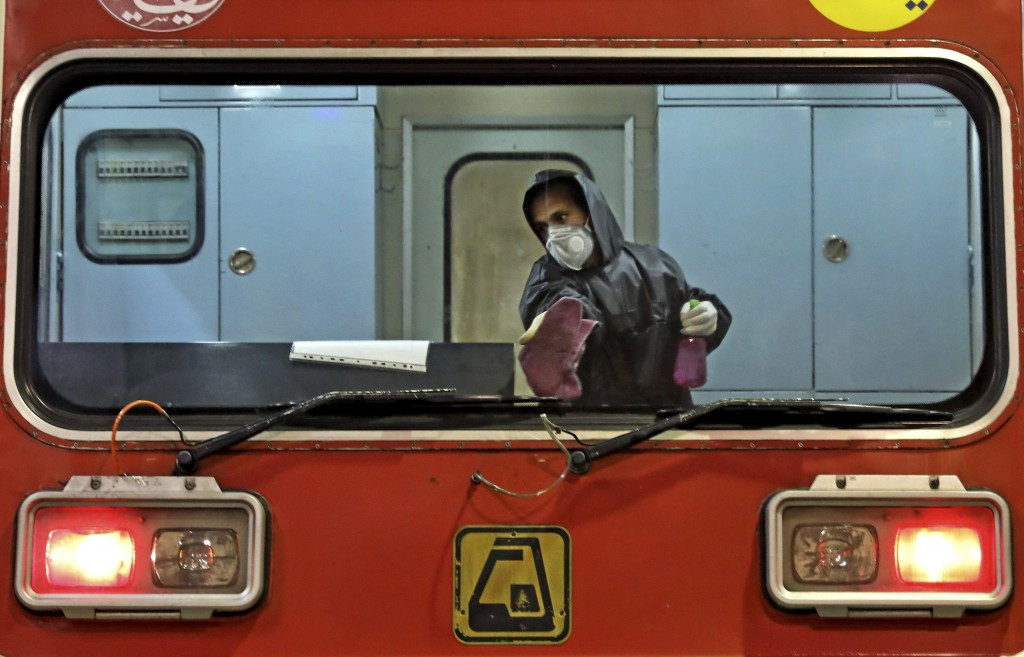 A worker disinfects subway trains against coronavirus in Tehran, Iran, in the early morning of Wednesday, Feb. 26, 2020. Iran's government said Tuesda...