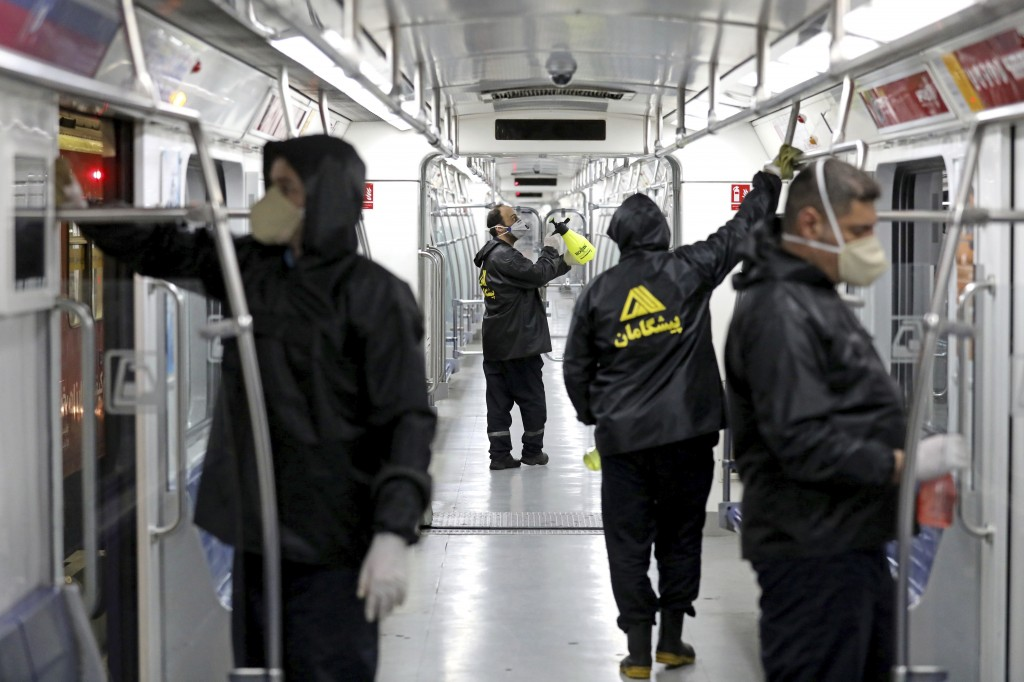 Workers disinfect subway trains against coronavirus in Tehran, Iran, in the early morning of Wednesday, Feb. 26, 2020. Iran's government said Tuesday ...