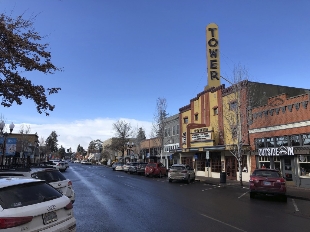 This Jan. 28, 2020 photo shows the Tower theatre located in downtown Bend, Ore., where the population in the early 1990's was around 25,000 and leaned...