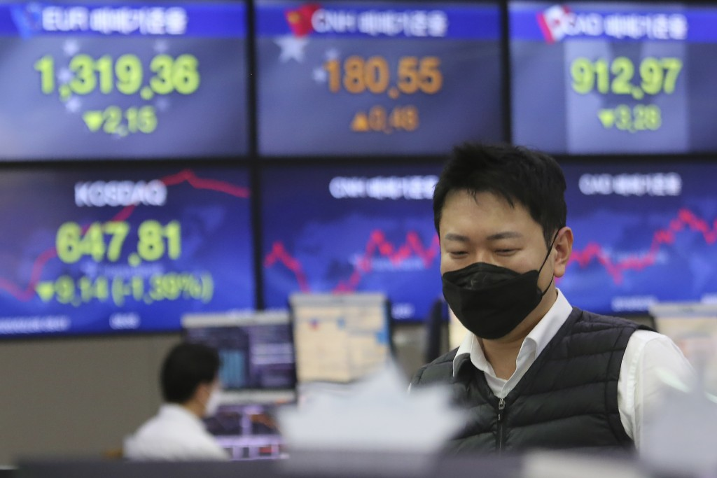A currency trader watches monitors at the foreign exchange dealing room of the KEB Hana Bank headquarters in Seoul, South Korea, Wednesday, Feb. 26, 2...