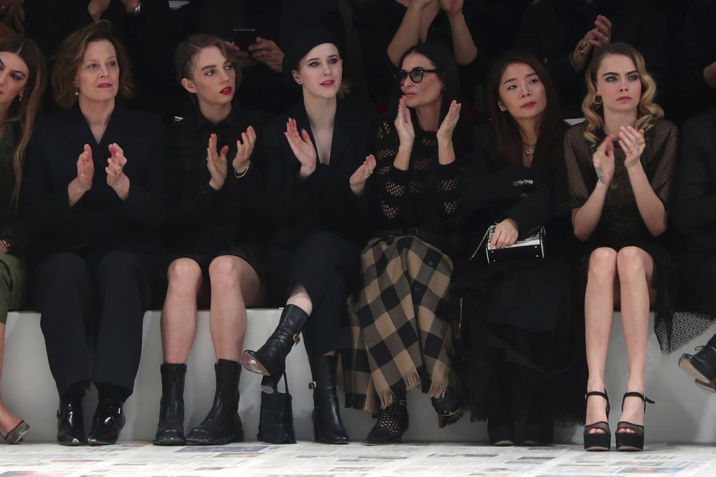 From left, Sigourney Weaver, her daughter Charlotte, Rachel Brosnahan, Demi Moore, and Cara Delevingne applause at the end of the Dior fashion collect...
