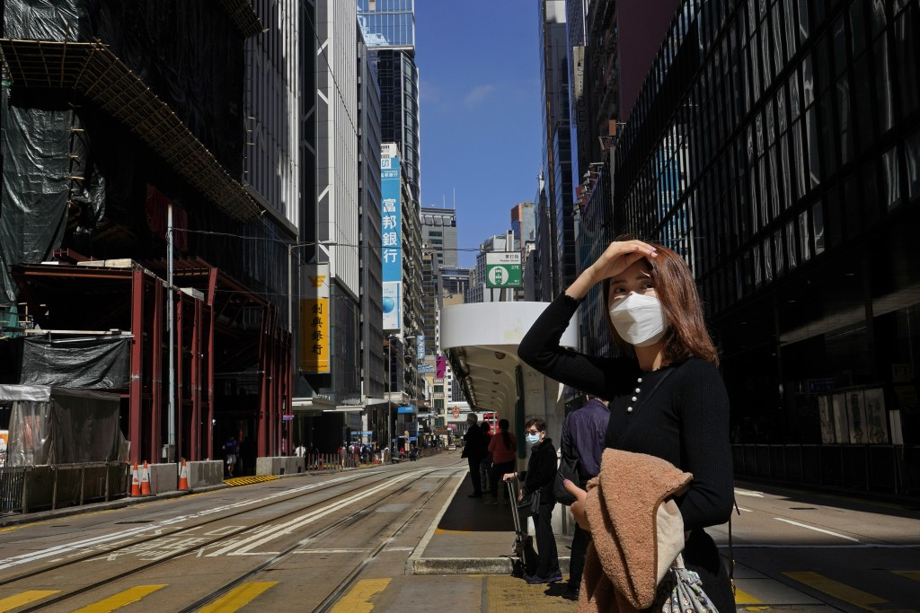 A woman wearing face mask walks on a down town street in Hong Kong Wednesday, Feb. 26, 2020. COVID-19 viral illness has sickened tens of thousands of ...