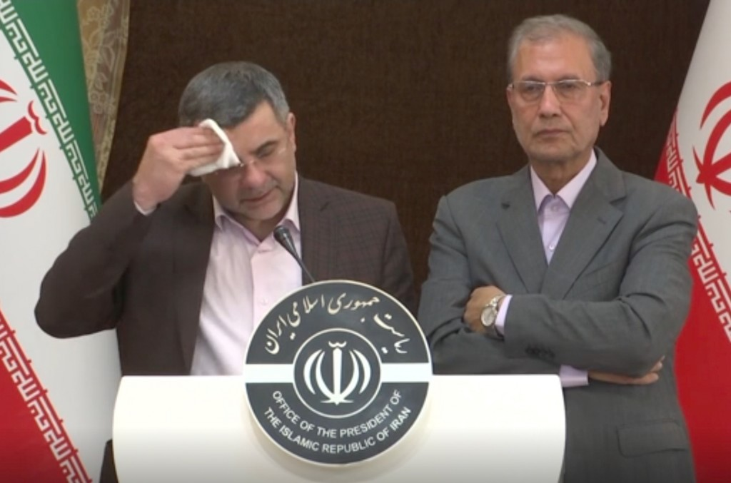 In this Monday Feb. 24, 2020 image made from video the head of Iran's counter-coronavirus task force, Iraj Harirchi, left, wipes his face during a pre...