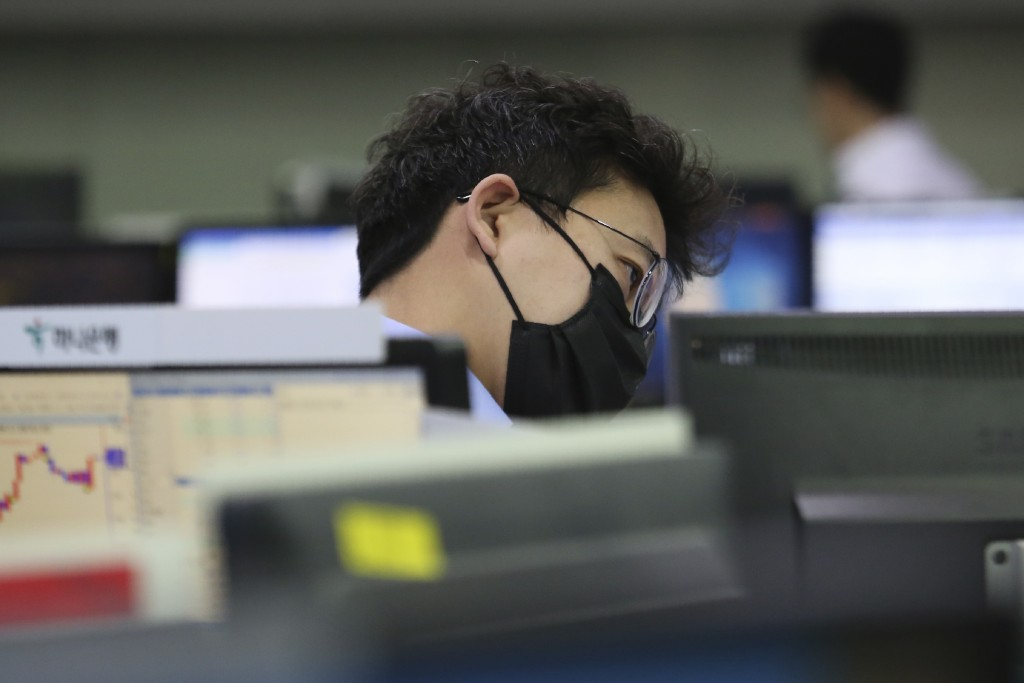 A currency trader watches monitor at the foreign exchange dealing room of the KEB Hana Bank headquarters in Seoul, South Korea, Wednesday, Feb. 26, 20...
