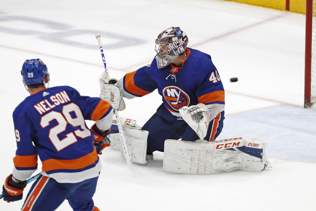 A shot by New York Rangers' Mika Zibanejad gets past New York Islanders goaltender Semyon Varlamov (40) as center Brock Nelson (29) watches in the ope...