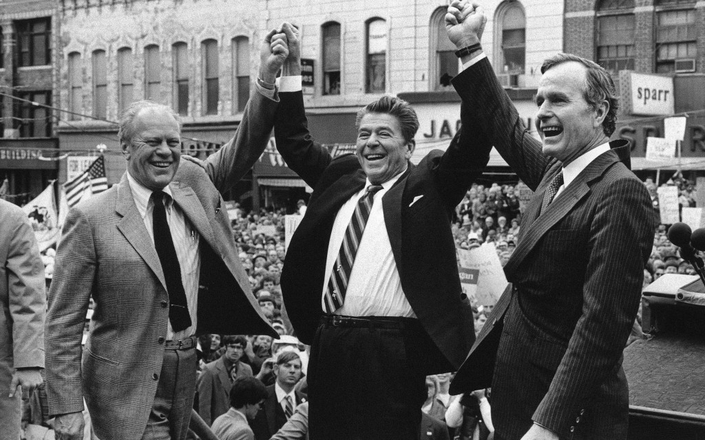 FILE - In this Nov. 3, 1980 file photo, former President Gerald Ford, from left, lends his support to Republican presidential candidate Ronald Reagan ...