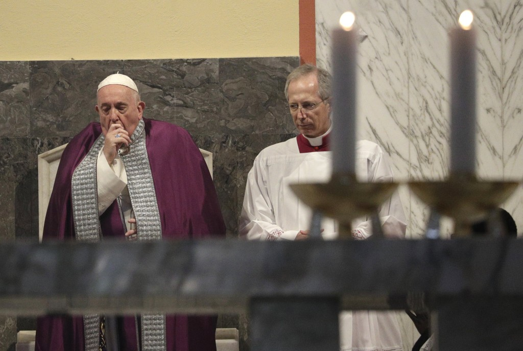 In this picture taken Wednesday, Feb. 26, 2020, Pope Francis coughs inside the Basilica of Saint Anselmo prior to the start of a procession to the Bas...