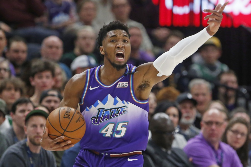Utah Jazz guard Donovan Mitchell gestures to teammates during the first half of the team's NBA basketball game against the Boston Celtics on Wednesday...