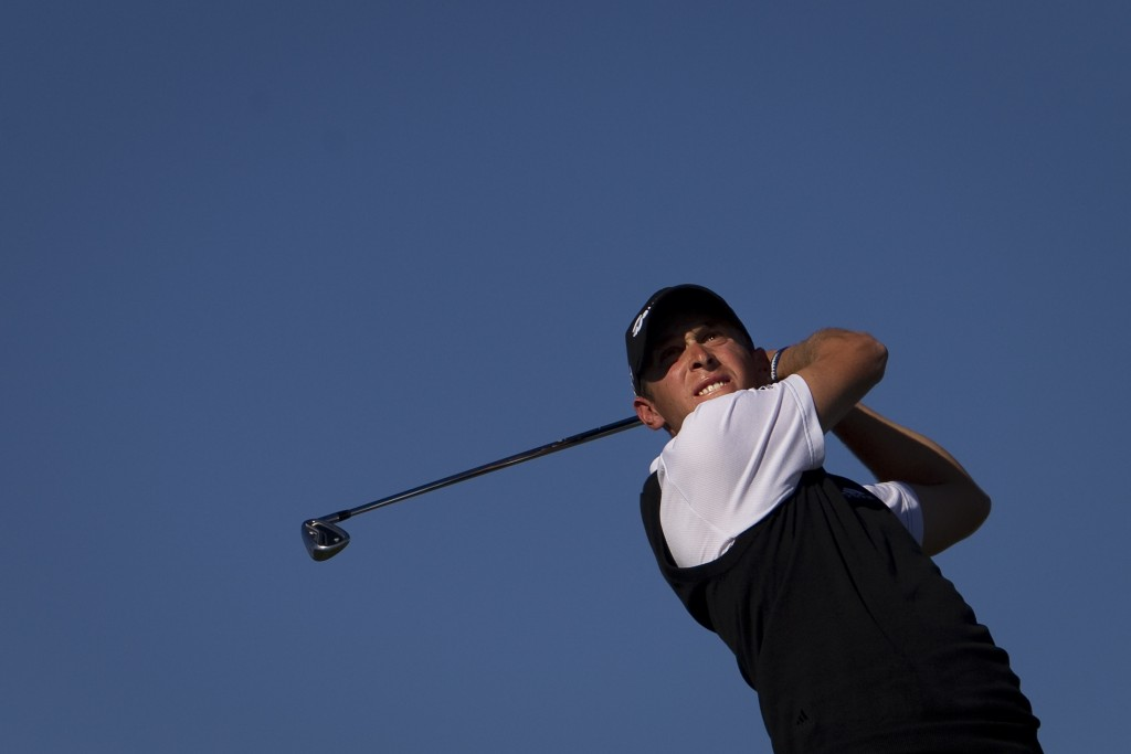 FILE - In this Sunday, Oct. 9, 2011 file photo, Lorenzo Gagli from Italy hits his drive from the 16th tee during the fourth round of the Madrid Master...