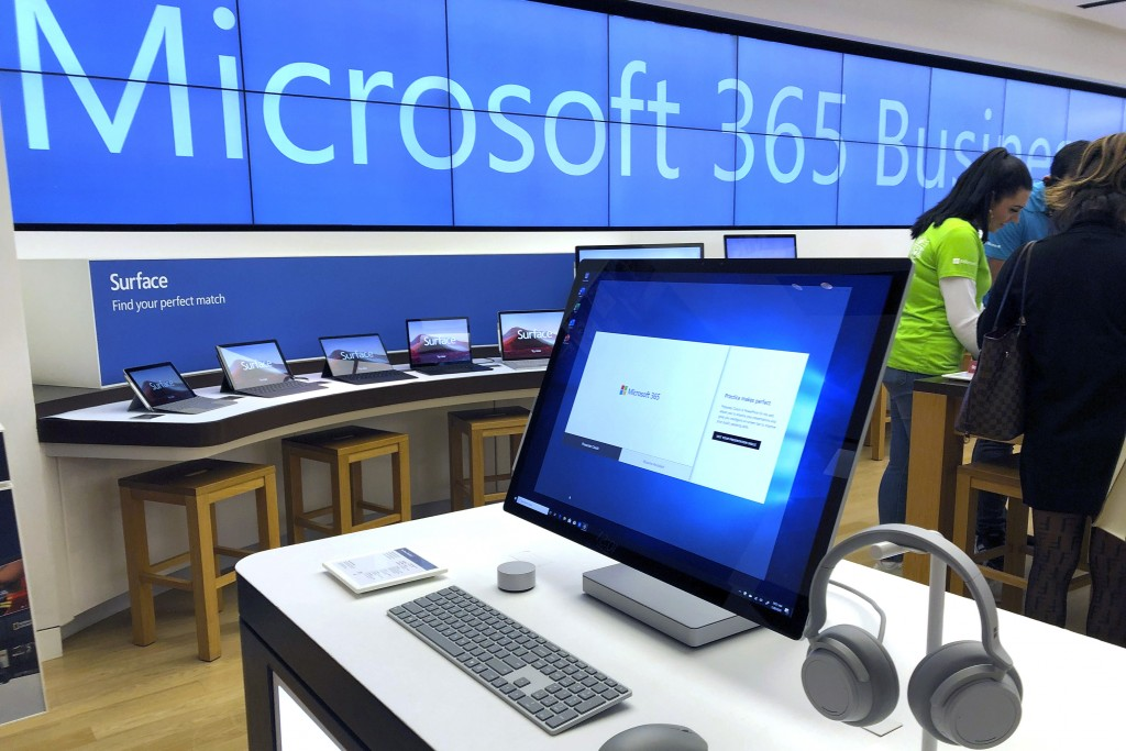 FILE - In this Jan. 28, 2020, file photo a Microsoft computer is among items displayed at a Microsoft store in suburban Boston. Microsoft says its sup...