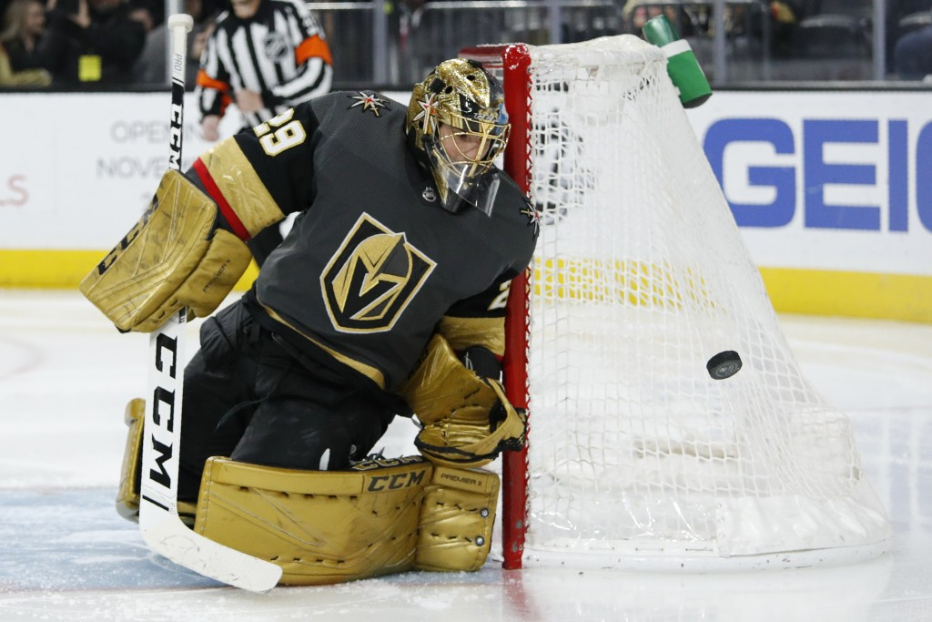 Vegas Golden Knights goaltender Marc-Andre Fleury (29) blocks a shot by the Edmonton Oilers during the third period of an NHL hockey game Wednesday, F...