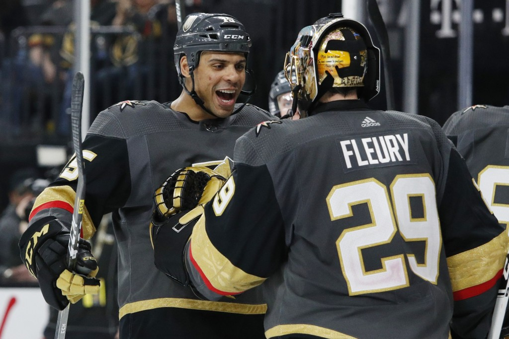 Vegas Golden Knights' Ryan Reaves, left, celebrates with goaltender Marc-Andre Fleury after defeating the Edmonton Oilers in an NHL hockey game Wednes...