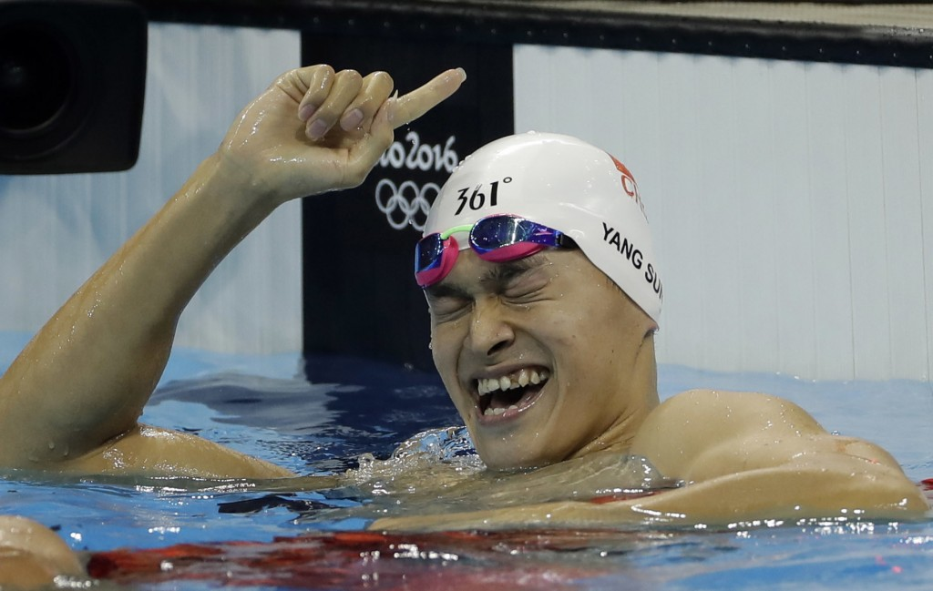 FILE - In this Monday, Aug. 8, 2016 file photo China's Sun Yang celebrates winning the final of the men's 200-meter freestyle during the swimming comp...