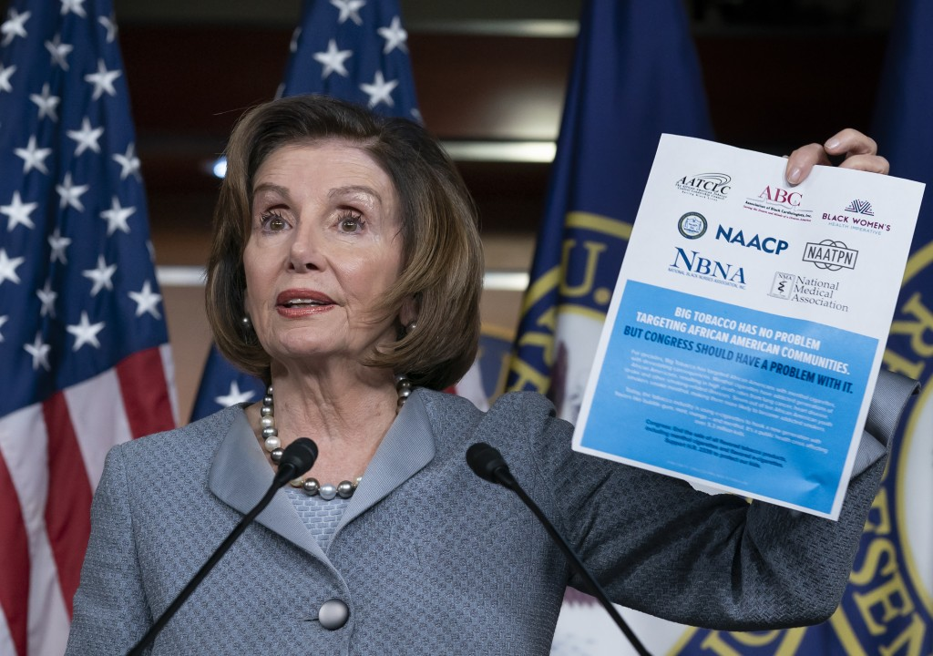 Speaker of the House Nancy Pelosi, D-Calif., displays an advocacy ad that criticizes the tobacco and vaping industry for allegedly targeting young Afr...