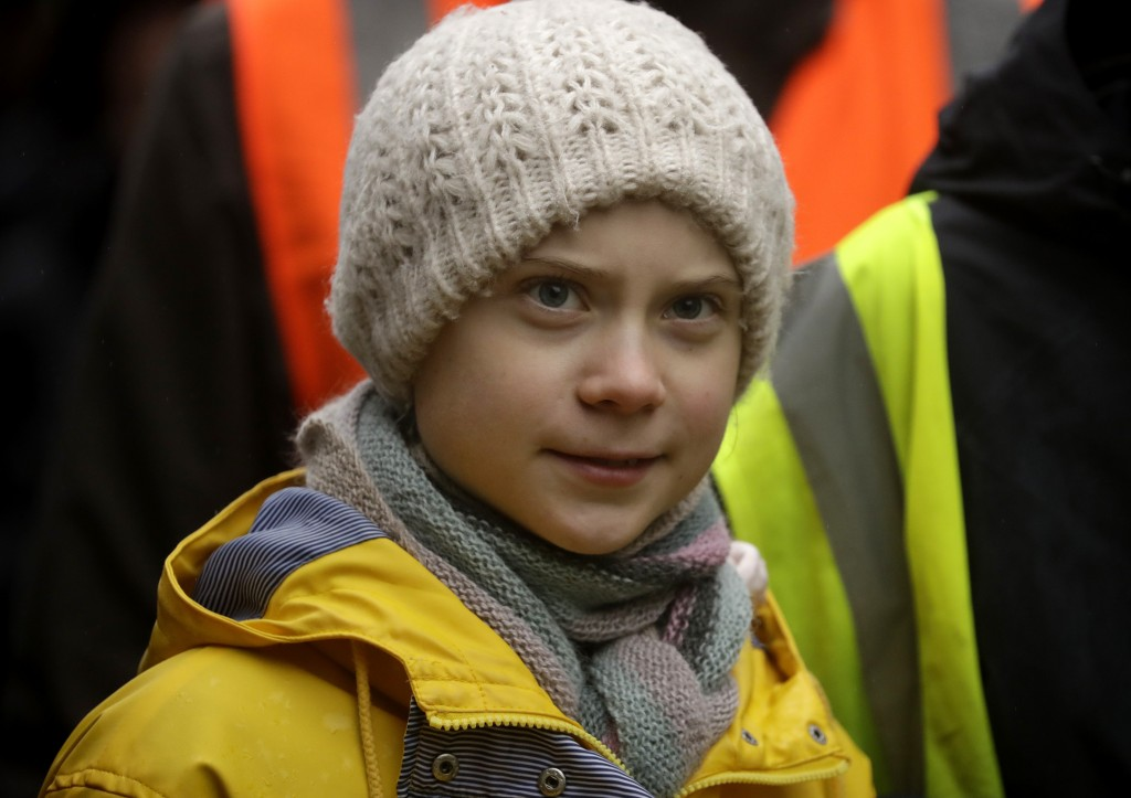 Climate activist Greta Thunberg, from Sweden marches with other demonstrators as she participates in a school strike climate protest in Bristol, south...