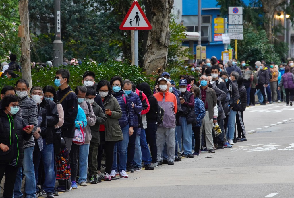 FILE - In this Feb. 5, 2020, file photo, citizens line up to buy face masks in Hong Kong. Fear of the spreading coronavirus has led to a global run on...