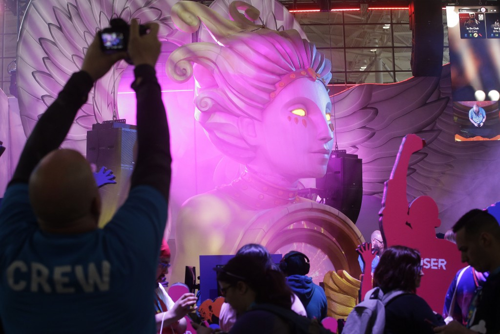 An oversize statue sits at the center of a display for Fuser, a music-mixing game, at the Pax East conference, Thursday, Feb. 27, 2020, in Boston. Tho...