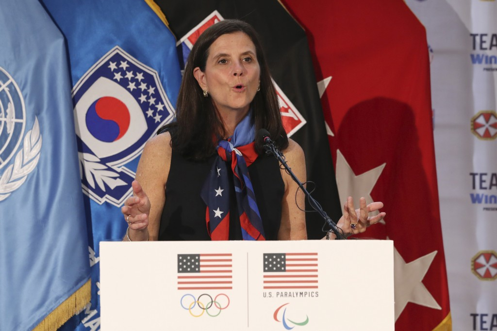 FILE - In this Aug. 1, 2017, file photo, then-U.S. Olympic Committee chief marketing officer Lisa Baird speaks about the Team USA WinterFest for the u...
