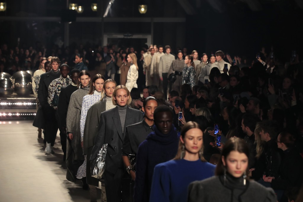 Models wear creations for the Isabel Marant fashion collection during Women's fashion week Fall/Winter 2020/21 presented in Paris, Thursday, Feb. 27, ...