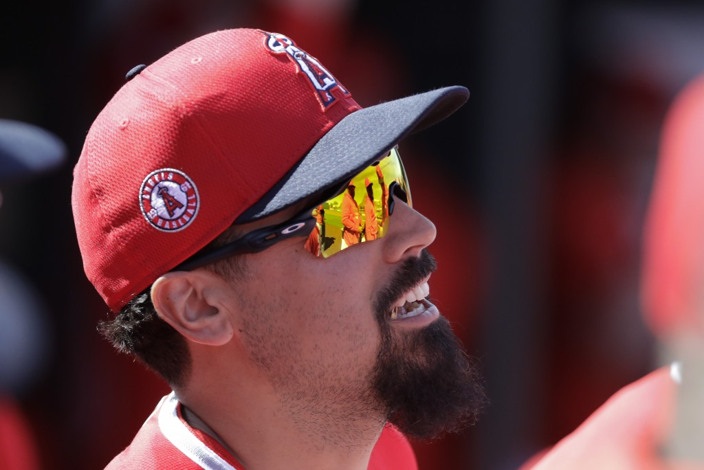 Los Angeles Angels' Anthony Rendon talks with teammates before a spring training baseball game against the San Diego Padres, Thursday, Feb. 27, 2020, ...