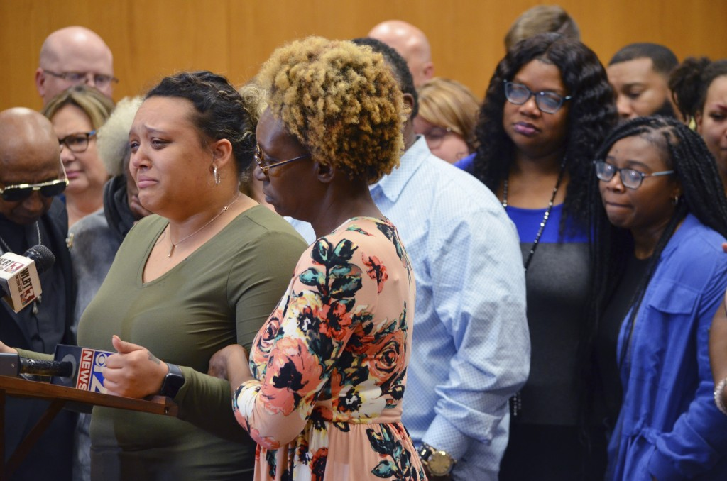 Christianna May Kelly, left, is comforted by her aunt Shonda May as she speaks to the media, Thursday, Feb. 27, 2020, at the Pike County Courthouse in...