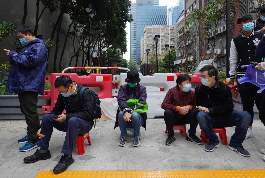 FILE - In this Feb. 5, 2020, file photo, locals wait to buy face masks in Hong Kong. Fear of the spreading coronavirus has led to a global run on sale...
