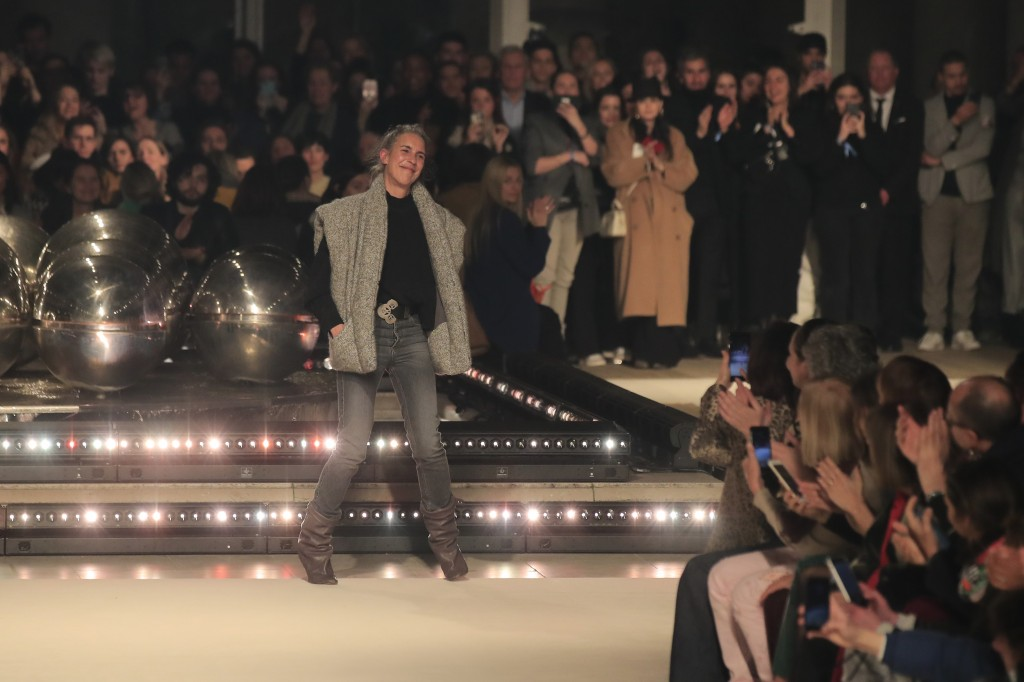 Designer Isabel Marant accepts applause after her fashion collection during Women's fashion week Fall/Winter 2020/21 presented in Paris, Thursday, Feb...