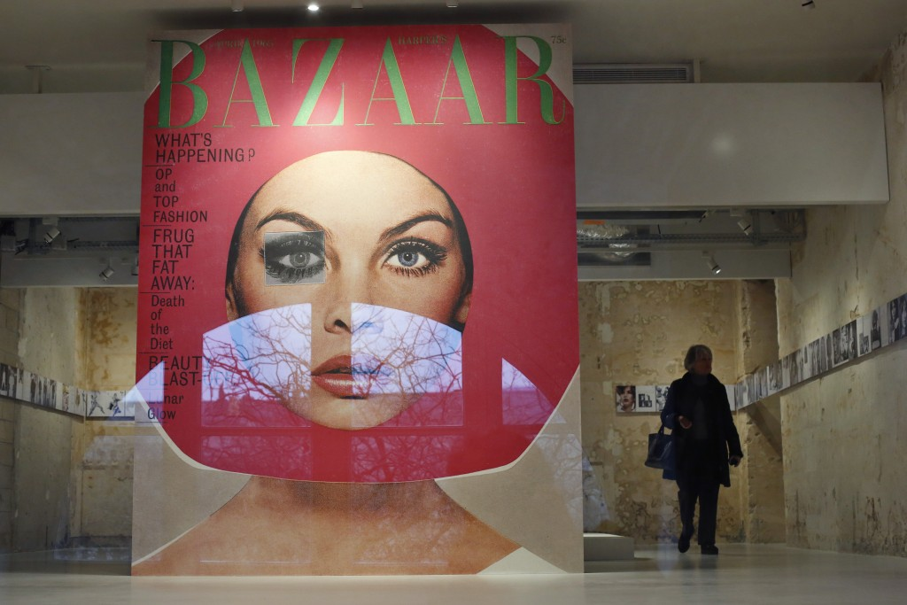 A visitor walks by a giant cover from Harper's Bazar magazine as part of the exhibition «Harper's Bazaar, First in Fashion» at the The Musée des Art...