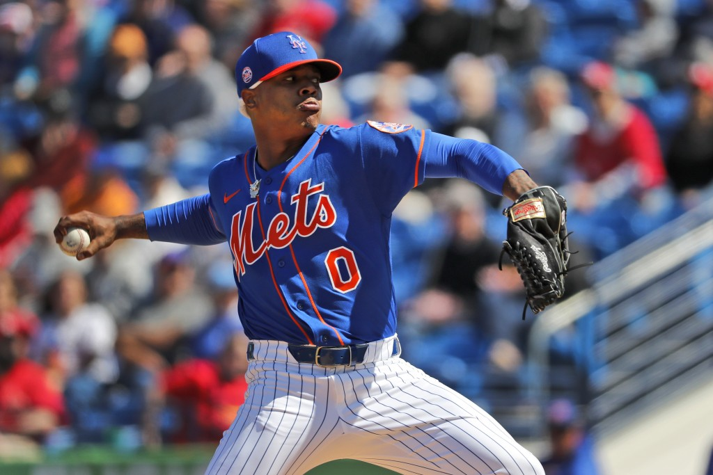 New York Mets pitcher Marcus Stroman throws during the first inning of a spring training baseball game against the St. Louis Cardinals Friday, Feb. 28...