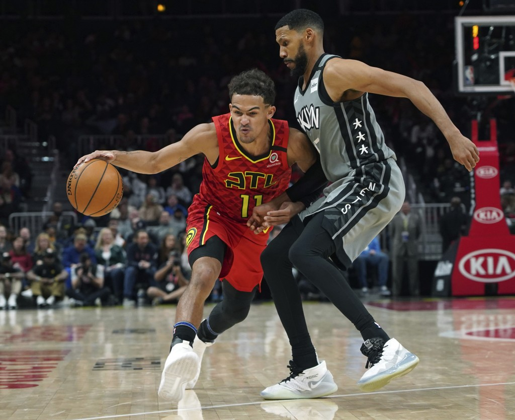 Brooklyn Nets guard Garrett Temple, right, defends against Atlanta Hawks Trae Young (11) in the second half of an NBA basketball game Friday, Feb. 28,...