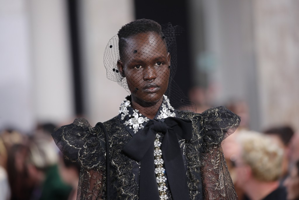 A model wears a creation for the Elie Saab fashion collection during Women's fashion week Fall/Winter 2020/21 presented in Paris, Saturday, Feb. 29, 2...