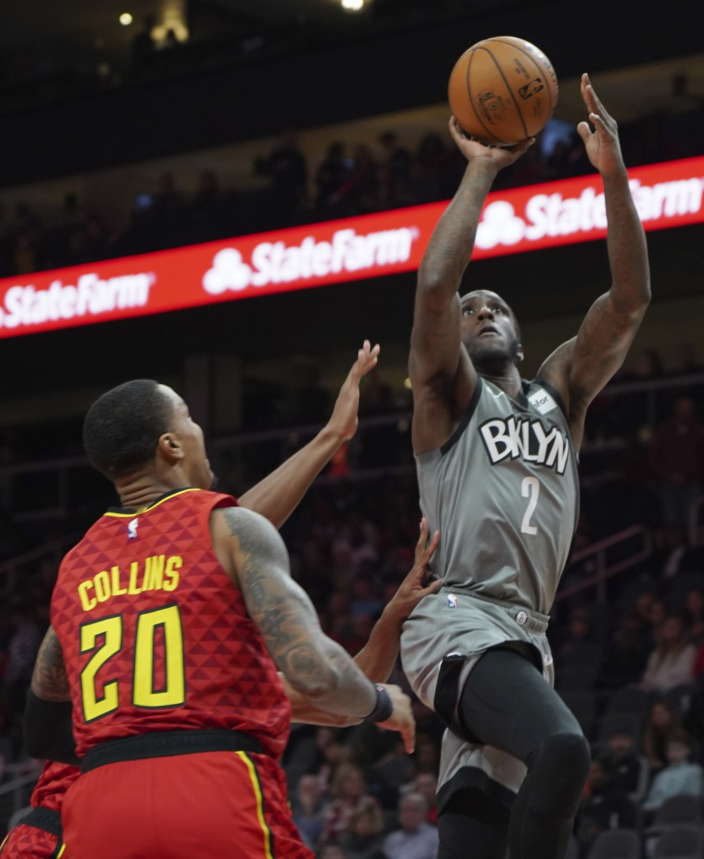 Brooklyn Nets Taurean Prince shoots past Atlanta Hawks John Collins (20) in the first half of an NBA basketball game Friday, Feb. 28, 2020, in Atlanta...