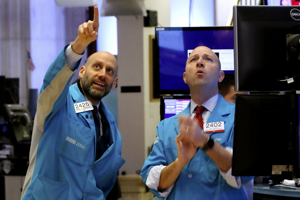Specialists Meric Greenbaum, left, and Jay Woods work on the floor of the New York Stock Exchange, Friday, Feb. 28, 2020. Stocks are opening sharply l...