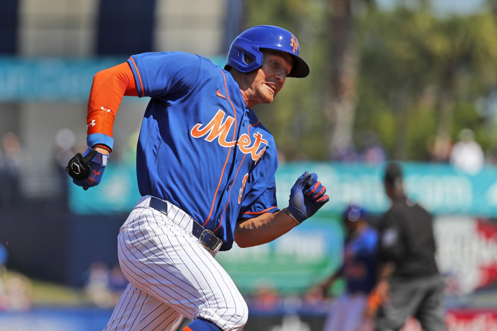 New York Mets' Brandon Nimmo rounds third and heads home to score on a single by Dominic Smith during the first inning of a spring training baseball g...