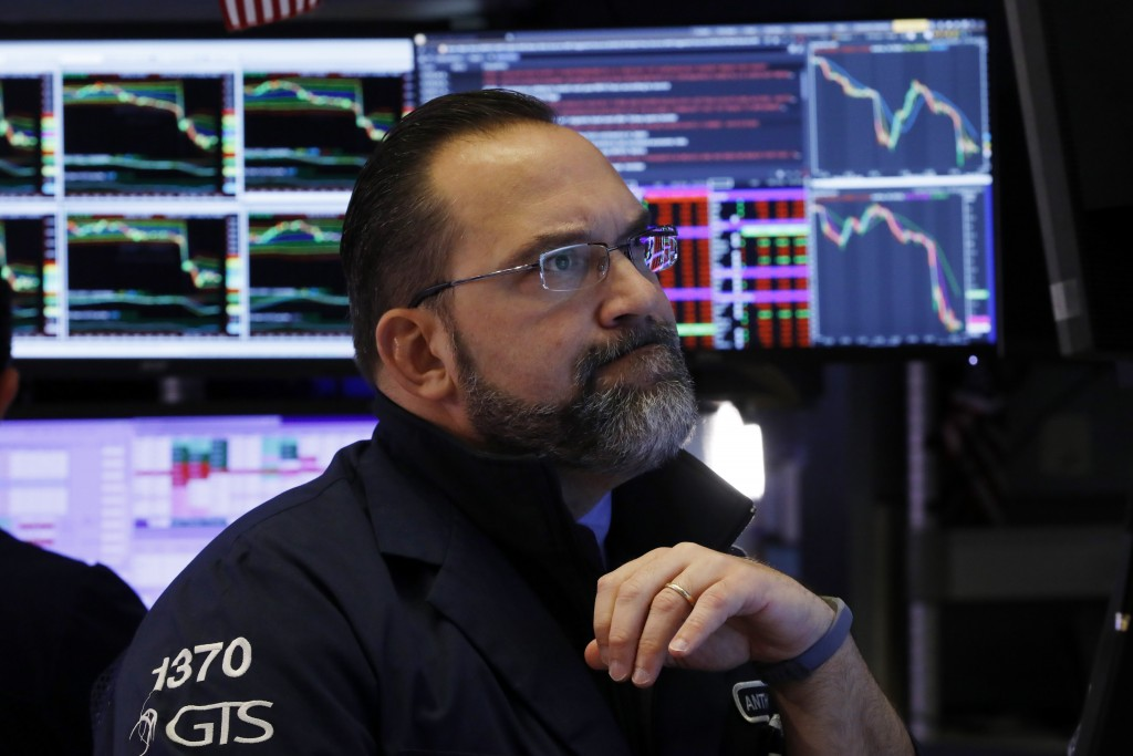 Specialist Anthony Matesic works at his post on the floor of the New York Stock Exchange, Friday, Feb. 28, 2020. Stocks are opening sharply lower on W...