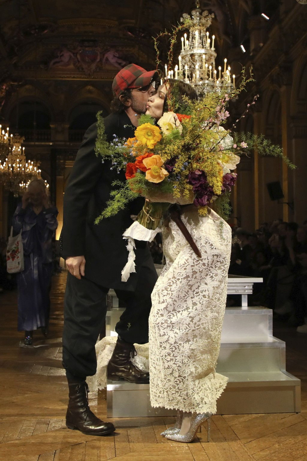 Designer Andreas Kronthaler, left, kisses model Bella Hadid after the Vivienne Westwood fashion collection during Women's fashion week Fall/Winter 202...