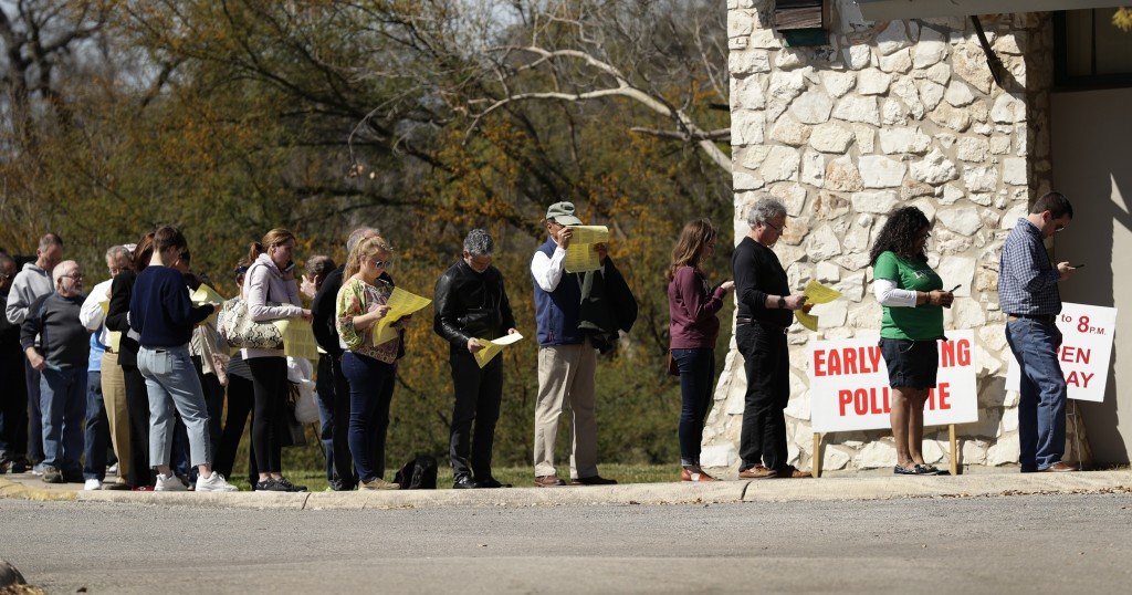 Voters wait in line at an early polling site in San Antonio, Friday, Feb. 28, 2020. Friday is the final day for early voting and Election Day is Tuesd...