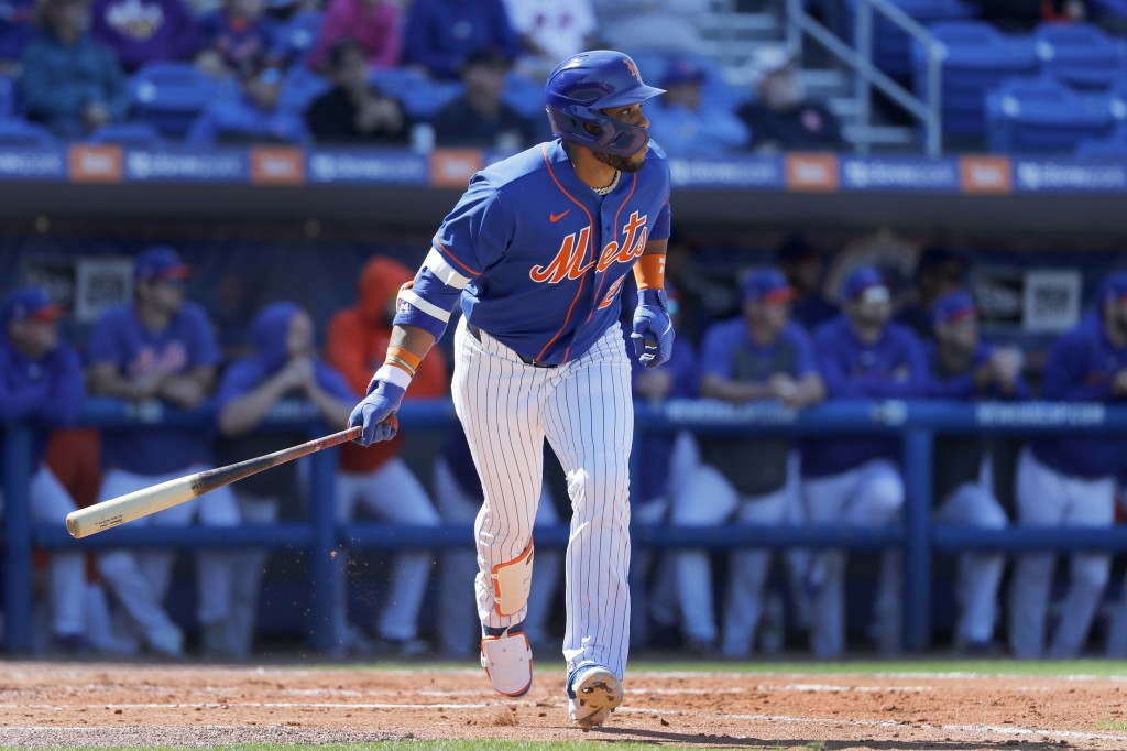 New York Mets' Robinson Cano watches as he flies out during the third inning of a spring training baseball game against the St. Louis Cardinals Friday...