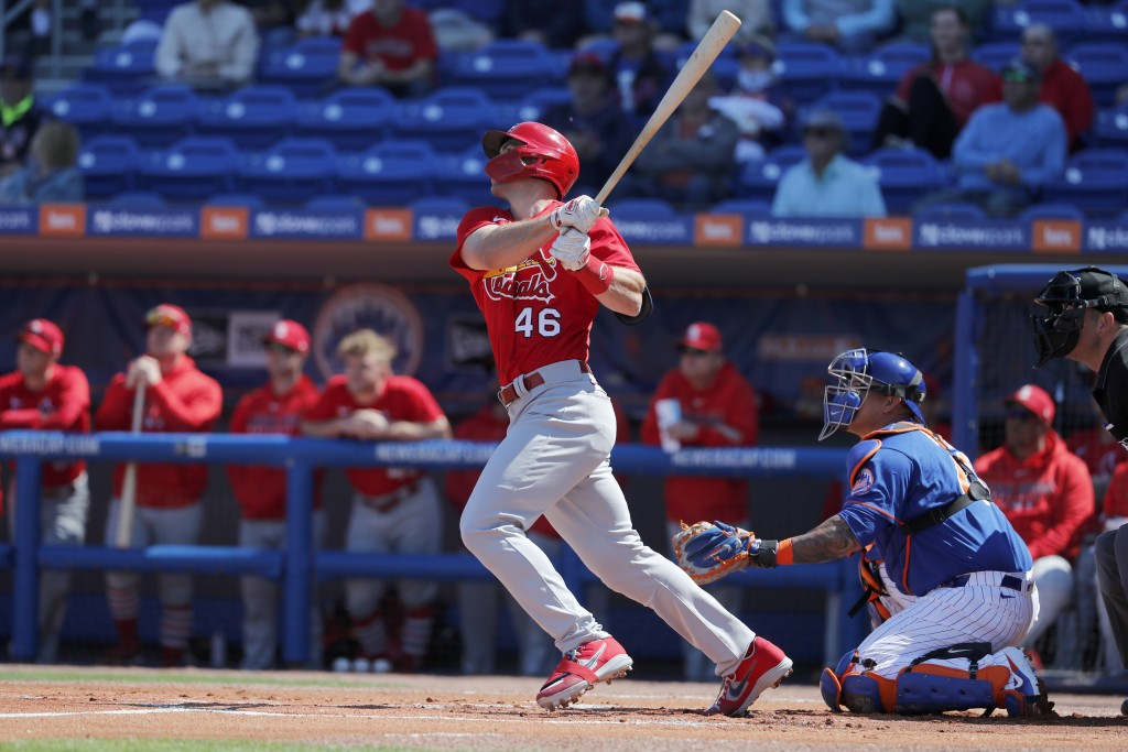 St. Louis Cardinals' Paul Goldschmidt (46) follows through on a solo home run during the first inning of a spring training baseball game against the N...